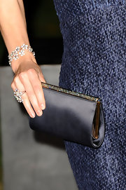 Claire Forlani held a classic black satin clutch at a Raisa Gorbachev Foundation event.