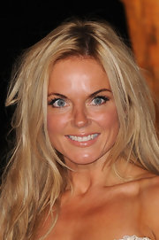 Geri Halliwell wore a shiny, nude lip color at a Raisa Gorbachev Foundation fundraiser. To try her look, select a moisturizing lipstick in a hue just a shade or two deeper than your natural lip color. The look is polished without looking overdone.