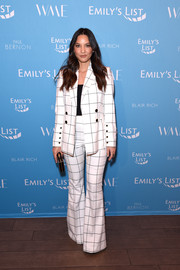 Olivia Munn channeled the '70s in a grid-patterned bell-bottom pantsuit by Rebecca Vallance at the Raising Our Voices event.