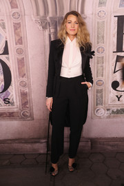 Blake Lively styled her suit with a pair of pompom-embellished peep-toes by Christian Louboutin.