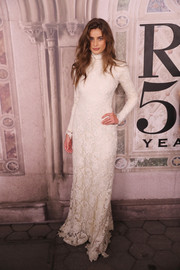 Taylor Hill was sweet and elegant in a high-neck white lace gown at the Ralph Lauren fashion show.