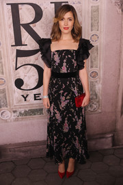 Rose Byrne went ultra girly in a Ralph Lauren floral dress with ruffle sleeves during the brand's fashion show.