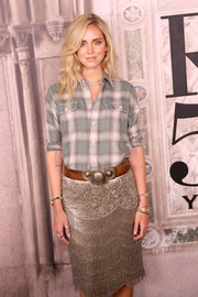Chiara Ferragni teamed a brown leather belt with a plaid shirt and a fringed gold skirt for her Western-glam look at the Ralph Lauren fashion show.