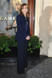 Isabelle Huppert attended the Ralph Lauren store opening wearing a classic navy blazer and wide-leg pants.