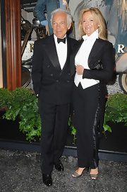 Ralph Lauren sported a tuxedo suit while hitting the opening of his new boutique.