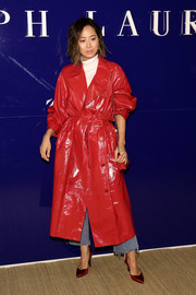 Aimee Song looked fabulous in a red patent trenchcoat by Ralph Lauren during the brand's Fall 2018 show.
