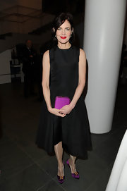 Elizabeth McGovern looked sweet in her black taffeta LBD and bright purple accessories.