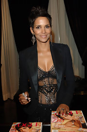 Halle Berry signed her cover issue of Vogue Magazine at the Ralph Lauren Celebration of Fashion's Night Out wearing oxidized sterling silver earrings with strands of champagne briolette diamonds.