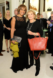 Barbara Walters added some color to her all-black outfit with a red cross-body tote when she attended the screening of 'To Catch a Thief.'