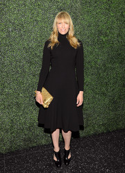 Toni Collette opted for a conservative black turtleneck dress by Ralph Lauren when she attended the screening of 'To Catch a Thief.'