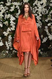 Bella Hadid looked effortlessly chic in this coral batwing dress while walking the Ralph Lauren runway.