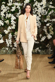 Kendall Jenner walked the Ralph Lauren show looking smart in a nude blazer layered over a white button-down.