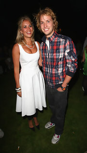 Holly Branson was girly in a white dress with a flared skirt at the Pre-Wimbledon Party.
