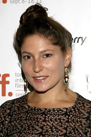 Stella Schnabel tied her locks up in a classic bun for the 2011 Toronto International Film Festival.