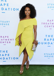 Angela Bassett cut a sophisticated figure in an off-one-shoulder, cape-sleeve dress by Greta Constantine at the Rape Foundation brunch.