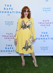 Christina Hendricks kept it fun in a yellow cat-print dress by Dolce & Gabbana at the Rape Foundation brunch.