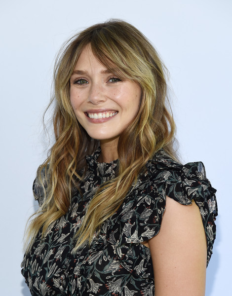 Elizabeth Olsen was a boho cutie with her long center-parted waves at the Rape Foundation brunch.