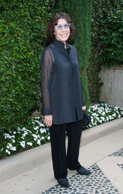 Lily Tomlin paired a sheer blue button-down with black slacks for the Rape Foundation's annual brunch.