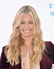 Beth Behrs looked like Barbie with her long blonde waves at the Rape Foundation brunch.