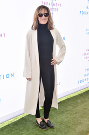 Underneath her coat, Felicity Huffman was sporty in black leggings and a matching turtleneck.