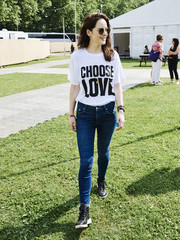 A pair of black high-top sneakers tied Michelle Dockery's casual look together.