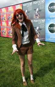 Florence steps into the wild side of fashion in a leopard print short suit at the Reading Music Festival.