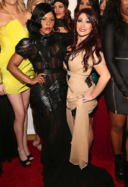 Lil Kim pulled off a leather and chiffon gown with lace peekaboo details at MBFW.
