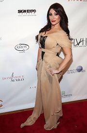 Deena Nicole Cortese wore a beige evening dress to The Reality of FASHION The Reality of AIDS event.