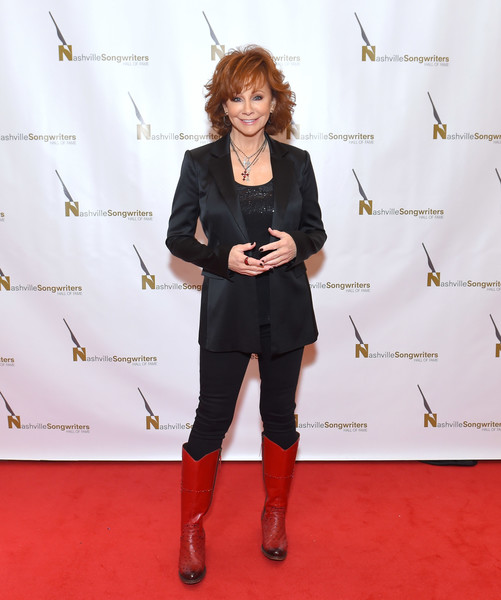 Reba McEntire Cowboy Boots [red carpet,carpet,flooring,footwear,fashion,joint,event,fashion design,shoe,style,reba mcentire,nashville,tennessee,music city center,nashville songwriters hall of fame,gala,nashville songwriters hall of fame gala]