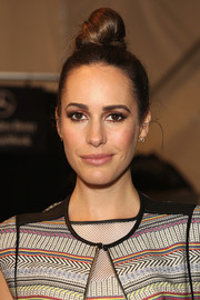 Louise Roe rocked a towering top knot during the Rebecca Minkoff fashion show.