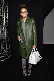 Zendaya Coleman showed off her fierce winter style with this green Rebecca Minkoff leather coat during the label's fashion show.
