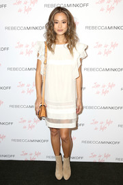 Jamie Chung toughened up her cute dress with nude suede ankle boots, also by Rebecca Minkoff.