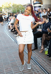 Keke Palmer completed her casual outfit with a button-front mini skirt.
