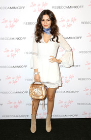 Victoria Justice teamed her frock with nude suede ankle boots, also by Rebecca Minkoff.