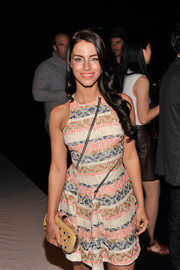 Jessica Lowndes attended the Rebecca Minkoff fashion show carrying an embellished nude hard-case clutch.