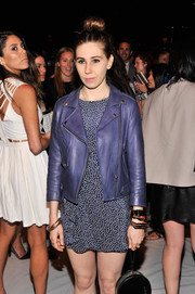 Zosia Mamet layered a moto-chic purple leather jacket over a print mini dress for the Rebecca Minkoff fashion show.
