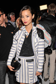 Jamie Chung infused some classic elegance into her modern look with a black leather clutch when she attended the Rebecca Minkoff fashion show.