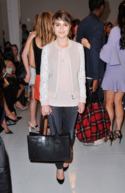 Sami Gayle donned a cute nude zip-up jacket with white lace sleeves for the Rebecca Taylor fashion show.