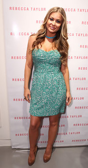 Carmen Electra looked sweet and chic in her mint green printed dress. She topped off the look with patent leather platform pumps.