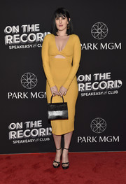Rumer Willis sported a figure-hugging yellow cutout dress by Reformation at the On the Record Speakeasy and Club grand opening.