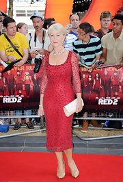 Helen Mirren showed off her hourglass shape and classic English style with this red knee-length, crystal-embellished cocktail dress.