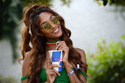 Jourdan Dunn amped up the hippie feel with a pair of round shades.