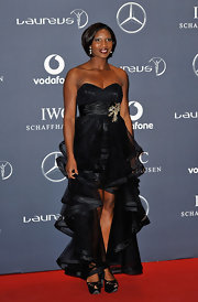 Denise Lewis topped off her asymmetrical frock with platform pumps.