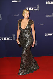 Kate Winslet looked divine at the Cesar Film Awards in this opulent gunmetal gown.