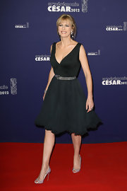 Karine Viard topped off her look with embellished peep-toe pumps.