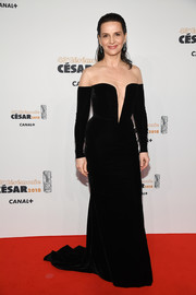 Juliette Binoche made a sultry-glam statement in a black velvet fishtail gown with a plunging illusion neckline at the 2018 Cesar Film Awards.