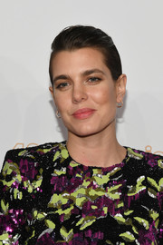 Charlotte Casiraghi finished off her look with a pair of small gold hoops.