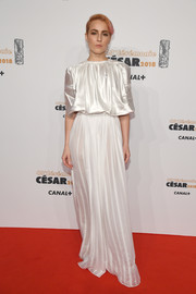 Noomi Rapace looked ethereal in a white gown with a loose satin bodice and a semi-sheer skirt at the 2018 Cesar Film Awards.