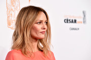 Vanessa Paradis attended the 2018 Cesar Film Awards wearing her hair in casual center-parted waves.