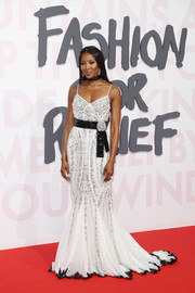 Naomi Campbell channeled her inner princess in a beaded white Dolce & Gabbana gown with a contrast belt and hem at the Fashion for Relief Cannes 2018.